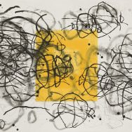 An original etching that has a white background, and in the center is a bold yellow square surrounded by black and gray swirls intersecting each other and layering on top of the yellow square